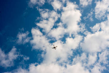 View of a photography drone on a blue sky Foto de archivo