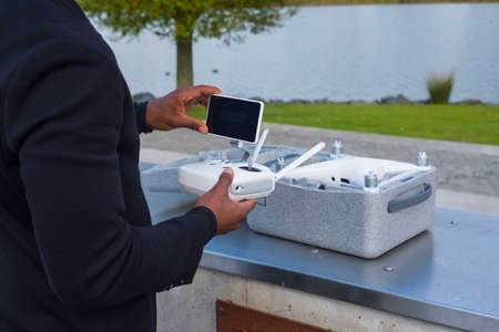 Drone equipment near a lake and the drone box delivered package