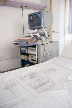 Medical ultrasound machine with linear probes in a hospital diagnostic room. Modern medical equipment, preventional medicine and healthcare concept.