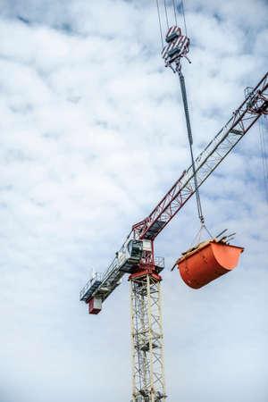 Crane transport debris and wood rests from a concrete structure building Foto de archivo