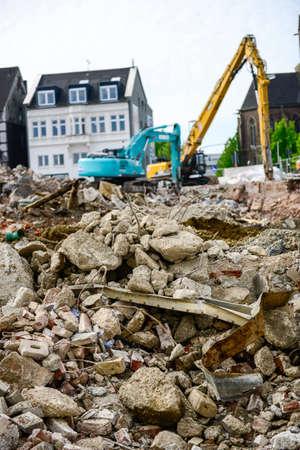 Mechanical grabber, bulldozer demolishes old buildings
