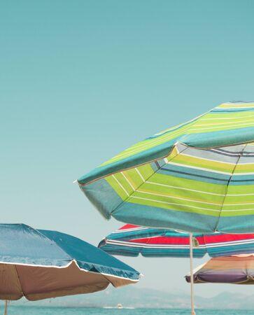 Striped beach umbrellas on the beach.