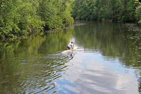 riverside tree: the sportswomen on a canoe