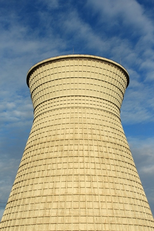 cooling: a cooling tower under a cloudy sky