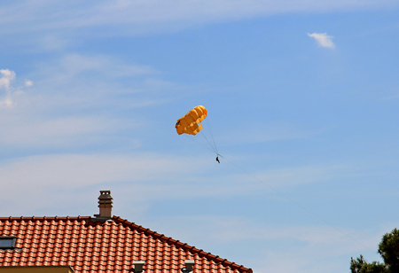 water parachute above the roof of the house Stock Photo