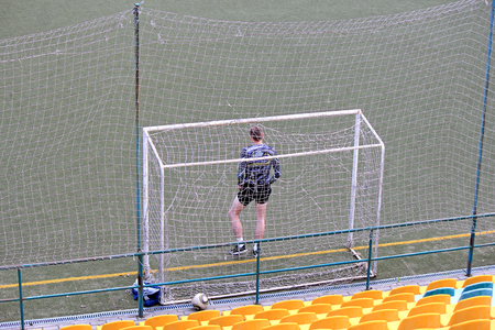 football goalkeeper misses the empty net