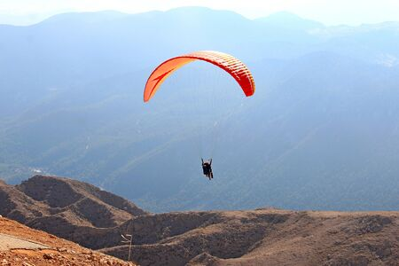 group of paragliders take off from high mountain Tahtali