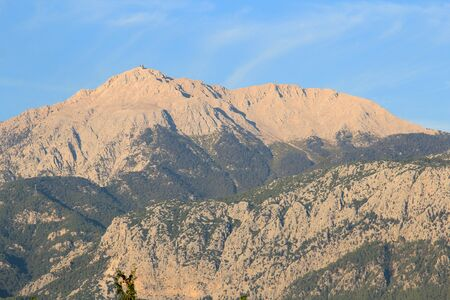 Mount Tahtali in the rays of the morning sun Фото со стока - 132220867