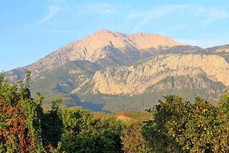 Mount Tahtali in the rays of the morning sun Фото со стока