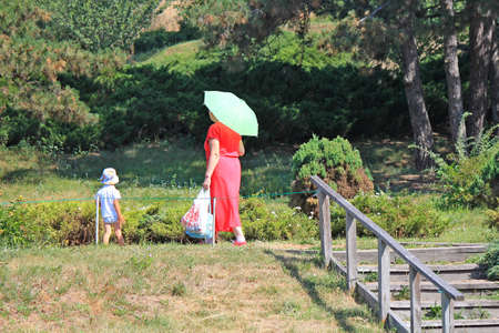 grandmother with her grandson on a walk in the botanical garden