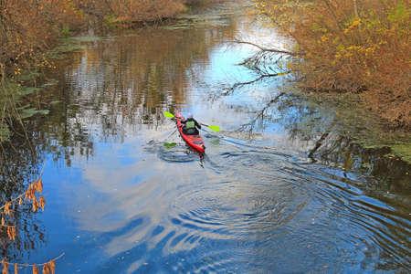 canoe rafting down the autumn river Фото со стока