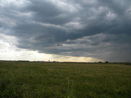 Storm clouds over a field  Reklamní fotografie