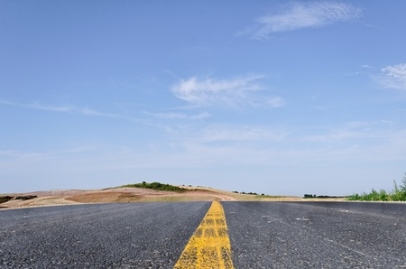 yellow line: an empty road with a yellow line i, the middle
