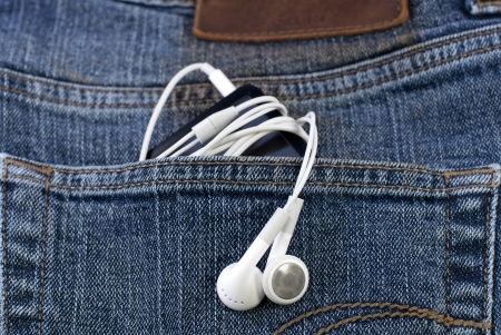 an mp3 player in the jeans pocket