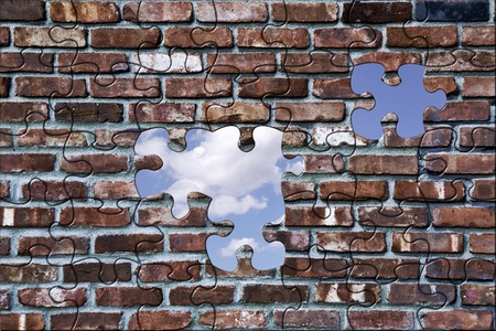 Hole in a brick wall with a view of the sky. photo