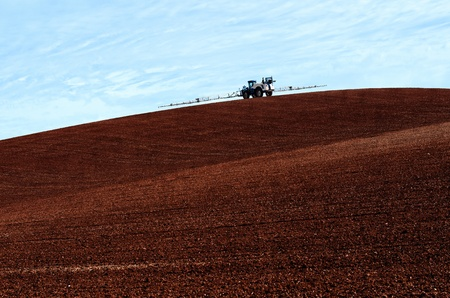 Chemical Spraying in a plowed field