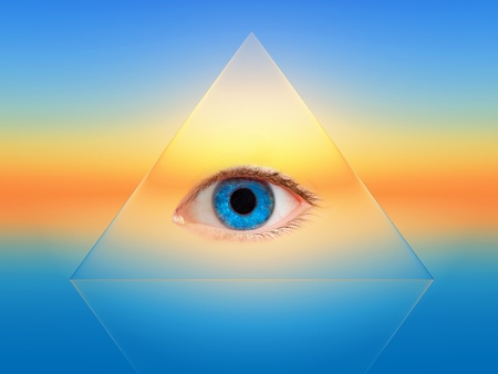 clairvoyance: a blue eye in a transparent pyramid Stock Photo