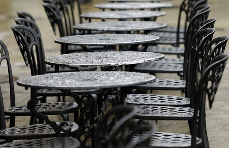 bistro tables on a rainy day photo