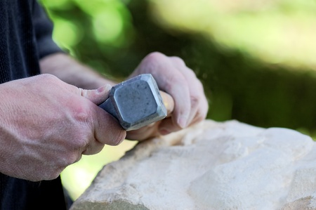 sculptor: stone sculptor at work