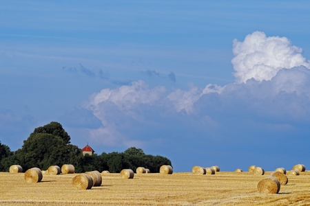 straw bales on stormy sky photo