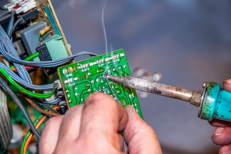solder: a technician made a repair with solder