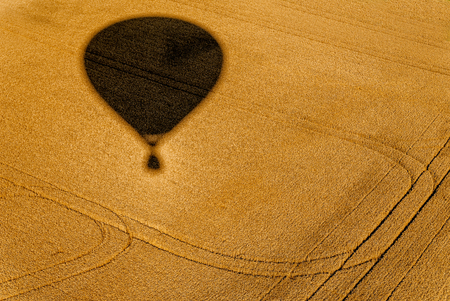 aerial view taken from a balloon,the shadow of the balloon in the fields