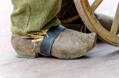 wooden shoes: old wooden shoes on foot