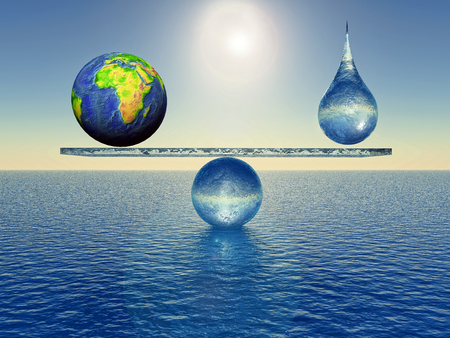 earth in balance with a drop of water Stock Photo
