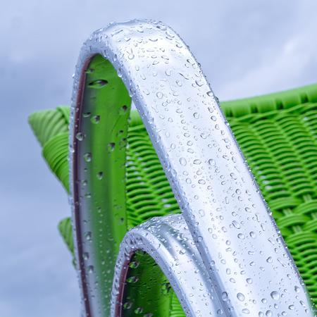 metallic: metallic armchair covered with rain drops