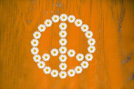 flower power: flower power sign made in daisy flower on wooden board