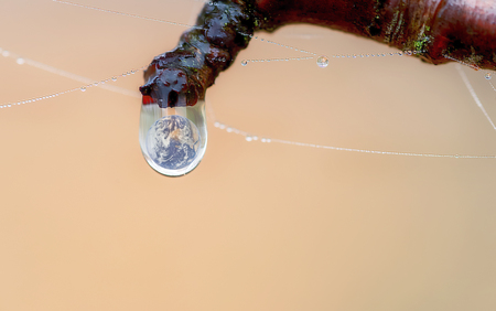 planet earth inside a rain drop Stock Photo