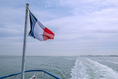 the stern of a boat with the french flag