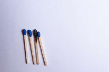 group of 4 matches and a burnt match, on a white background isolated Stock fotó