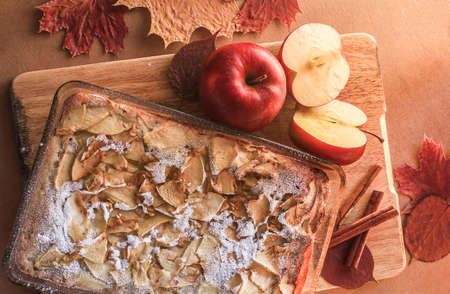 Delicious apple pie on a wooden board