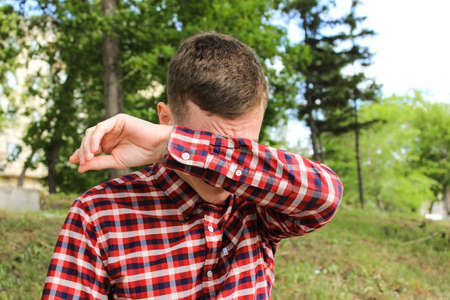 disgusted: The guy in the plaid shirt wipes his face