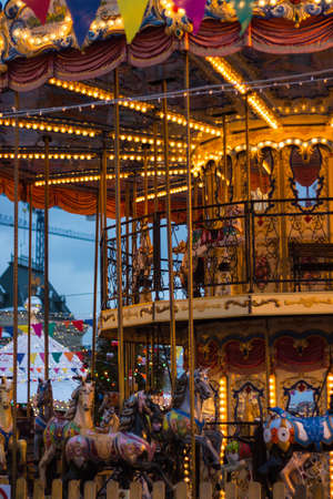 childrens carousel with horses, burning lights, carnival