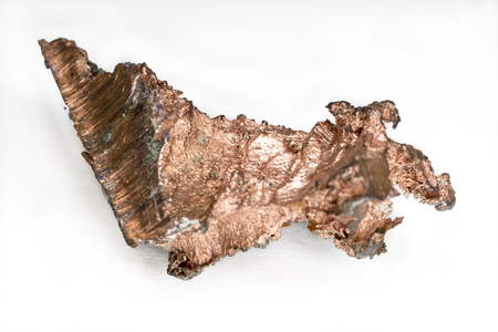 Close-up of natural copper nugget with crystal impurities. Macro, isolated.