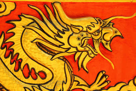 preaching: Dragon on temple wall Wat Khao ISan Thepprathan Ratchaburi, Thailand. Stock Photo