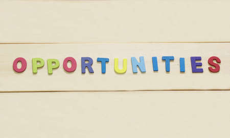 swot: The colorful word opportunity on wood background : SWOT Concept Stock Photo