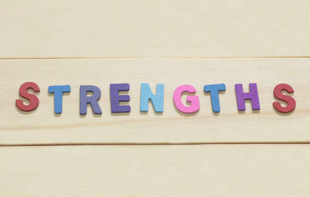 The colorful word Strengths on wood background : SWOT Concept