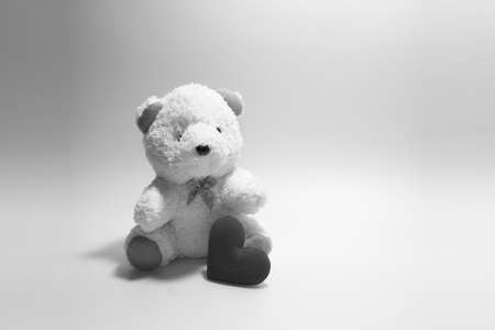 heart tone: teddy Bear with Heart concept valentine on soft black-white tone. light and shadow Stock Photo