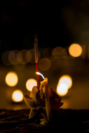 ritual: Candles ritual significance in Buddhism. Asalha Puja Day Stock Photo