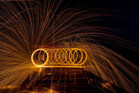 steel wool: Long Exposure Photography using Steel Wool Burning at night Stock Photo