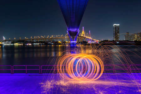 Steel wool and colorful  light of night at Bhumibol bridge in bangkok, thailand. Long exposure photography.