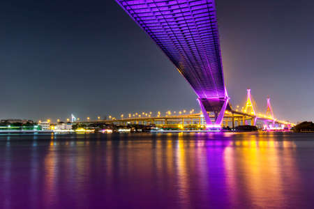 Colorful and light of night at Bhumibol bridge in bangkok, thailand. Long exposure photography.