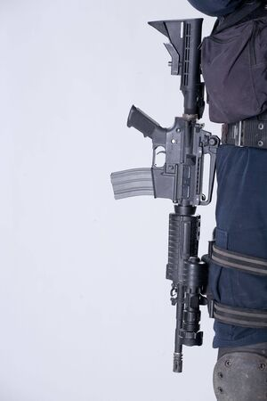 glock: The army automatic machine-gun hanging on a belt at the soldier