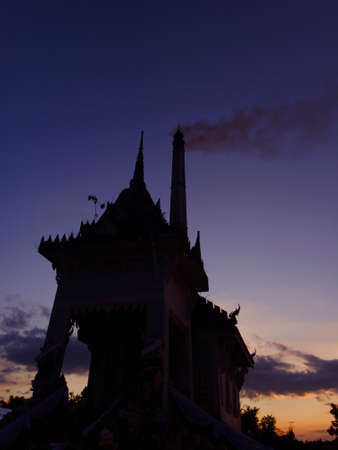 The cremation in the countryside of Thailand began at twilight.