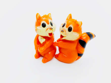 Two orange squirrels doll isolated on white background with clipping path. Stock Photo