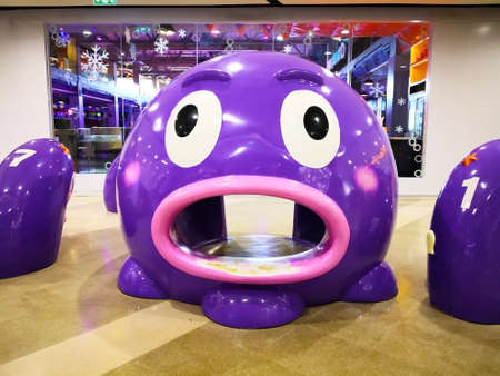 The player of the children, which is purple squid. And pink mouth, which opened so that children can pass through.