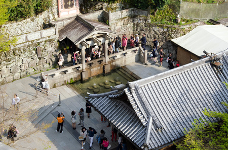queueing: Kiyomizu-dera  Pure Water Temple    People queueing up to drink or collect water from Otowa-no-taki waterfall by using metal cups to take water   for Health, Longevity and Wisdom  Have to choose only 2 of 3  Editorial